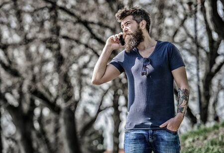 Man with beard calling. Bearded man call cell phone. Communication concept. Try call later. Redirected call. Listening message. Unavailable at the moment. Hipster with beard using mobile phone