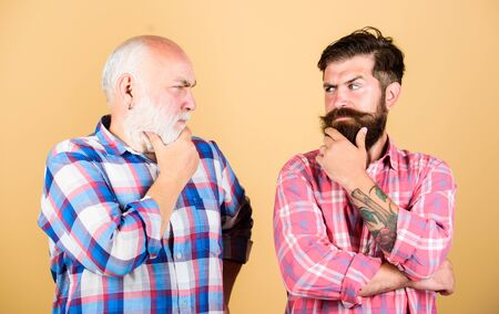 time to think. two bearded men senior and mature. youth vs old age compare. retirement. father and son family. generation conflict. barbershop and hairdresser. male beard care. checkered fashion