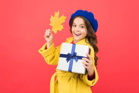 Just having fun. thanksgiving day. fall season. school shopping sales. happy small girl with maple leaf and present box. autumn kid fashion. girl child in french beret hold gift. Autumn weather.