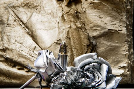 silver rose flower on gold background. luxury and success. metallized antique decor. wealth and richness. floristics business. Vintage retro. grunge beauty. collagen mask production concept Banque d'images