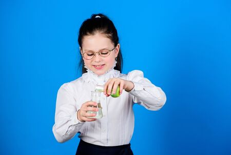 Experimenting a bit. Knowledge and information. Small kid study. Education concept. Basic knowledge. Knowledge day. Serious about studying. Schoolgirl with chemical liquids. Childhood and upbringing Foto de archivo