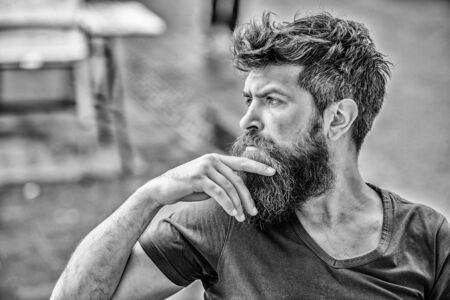 Making hard decision. Bearded man concentrated face. Hipster with beard thoughtful expression. Thoughtful mood concept. Making important life choices. Man with beard and mustache thoughtful troubled Фото со стока