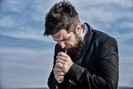 Mature hipster with beard. Bearded man smoking cigarette. Future success. Male formal fashion. brutal caucasian hipster with moustache. Businessman against the sky. smoke. Profit and richness concept