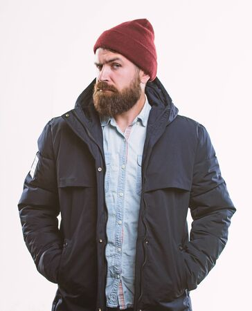 Hipster modern fashion. Guy wear hat and black winter jacket. Hipster style menswear. Hipster outfit. Stylish and comfortable. Man bearded hipster posing confidently in warm black jacket or parka