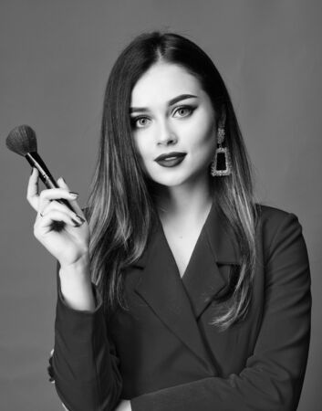 Sexy woman with professional makeup brush tool. beauty and fashion. hair beauty and hairdresser salon. jewelry earrings. Girl in red jacket. Fashion portrait of woman. Facial care
