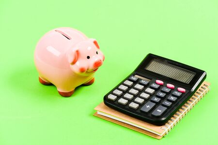 planning counting budget. Commerece business. capital management. moneybox with calculator. Piggy bank. money saving. Accounting and payroll. bookkeeping. financial report. Great chance to win. 写真素材