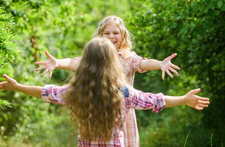finally met. girls friends meet in green forest. summer vacation. childrens day. happy little girls with long healthy hair. hair health and care. hairdresser fashion and beauty. long curly hair