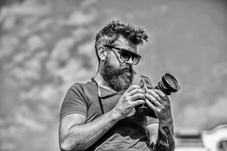 Content creator. Man bearded hipster photographer. Man shooting photos. Old but still good. Manual settings. Photographer hold vintage camera. Modern blogger. Photographer with beard and mustache Foto de archivo - 129457955