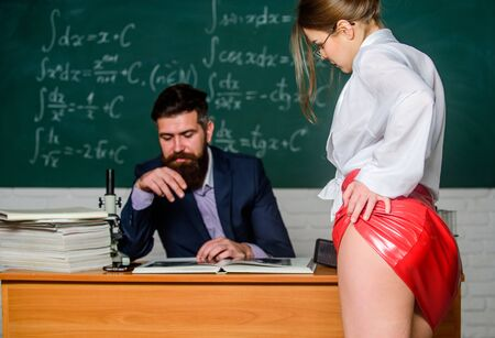 Sexy seduction. Sexy butt red latex skirt in front of teacher. Private lesson. Seductive offer. Check knowledge. Desire for knowledge. Sex knowledge. Need for real experience. Teacher and student