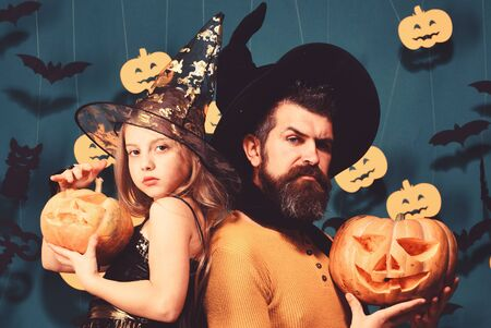 Father and daughter in costumes. Girl and bearded man Archivio Fotografico - 129823492