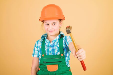 Labor day. 1 may. Foreman inspector. Repair. Safety expert. Future profession. small girl repairing in workshop. Little girl in helmet with hammer. Kid worker in hard hat. Working in repair shop
