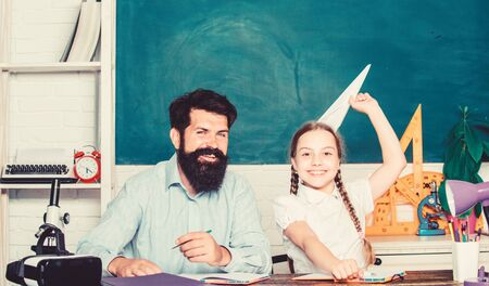 Focusing on work. back to school. Private teaching. small girl child with bearded teacher man in classroom. knowledge day. Home schooling. private lesson. daughter study with father. Teachers day Stock fotó - 129823547