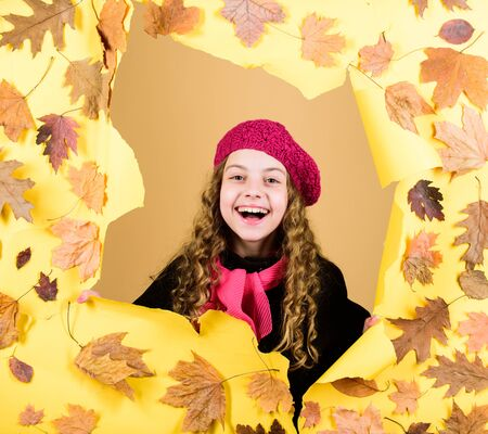 little girl in french beret. Fall fashion. parisian kid in autumn leaves. autumn beauty. Happy childhood. child in positive mood. little girl in trendy coat red scarf. Small child with autumn leaves