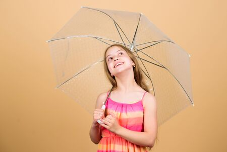rainy weather. Fall mood. small girl with umbrella. carefree childhood. autumn weather forecast. autumn fashion. child with trabsparent parasol. Trendy beauty