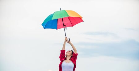Ready for new adventures. autumn fashion. Rainbow umbrella protection. carefree time spending. pretty woman with colorful umbrella. rainy weather. Fall positive mood. autumn weather forecast