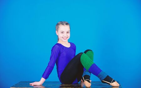 success. Childhood activity. Fitness diet. Energy. Sport and health. Gymnastics. Happy child sportsman. Acrobatics gym workout of teen girl. Striking the pose. her body is perfect. Warming up