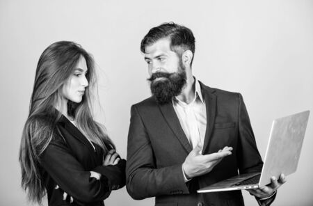 Business meeting. Discussing progress. Man bearded manager show financial report laptop. Woman and guy colleague working together. Business plan. Business lady and director or boss surfing internet