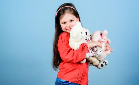 Lost in her fairytale. little girl playing game in playroom. hugging a teddy bear. happy childhood. Birthday. small girl with soft bear toy. child psychology toy shop. childrens day. Best friend