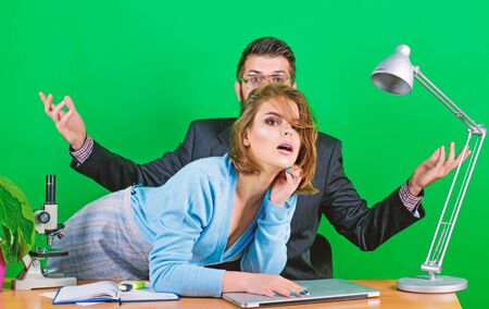what is going on. business couple at computer. woman and man work in office at laptop. corporate ethics. businessman and assistant. secretary with boss at workplace. love affair at work