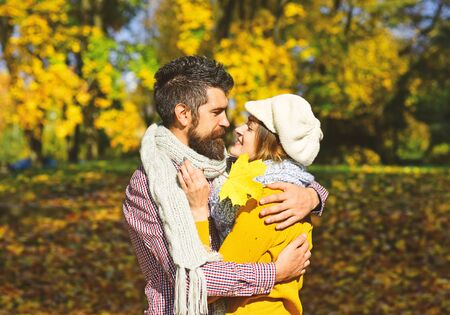 Man and woman with happy faces on autumn trees background. Stockfoto
