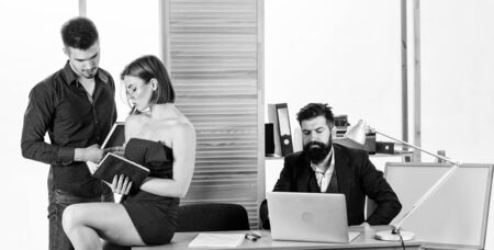 Office atmosphere concept. Sexual attraction. Stimulate sexual desire. Woman working in mostly male collective. Intentional sexual provocation. Woman attractive lady working with men colleagues Stockfoto