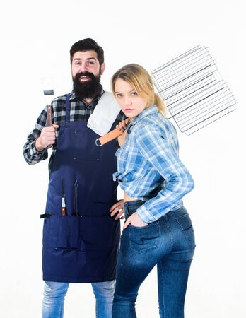 Perfect summer lunch. Tools for roasting meat. Man bearded hipster and girl. Preparation and culinary. Family weekend. Couple in love hold kitchen utensils. Picnic barbecue. food cooking recipe Stock Photo