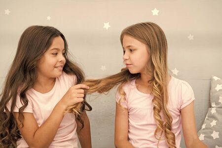 Girls sisters spend pleasant time communicate in bedroom. Benefits having sister. Awesome perks of having sister. Sisters older or younger major factor in siblings having more positive emotions Stok Fotoğraf