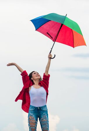 No rush. autumn weather forecast. rainy weather. Fall positive mood. carefree time spending. autumn fashion. Rainbow umbrella protection. pretty woman with colorful umbrella Reklamní fotografie