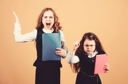 Stressful day at school. Education is what remains after one has forgotten what one has learned in school. Girls school pupils. Back to school. Knowledge day. Pass exam. Stress causes anxiety Stock Photo