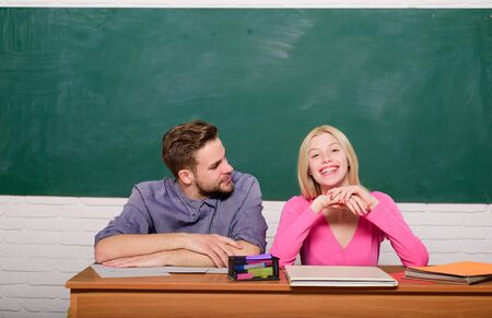 Student life. Lesson and blackboard. Teachers day. Couple of man and woman in classroom. Home schooling. Modern school. Knowledge day. Back to school. Happy couple. Relaxing before the next class