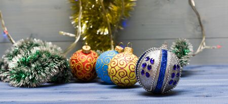 Christmas balls decoration on blue wooden surface. Winter holiday concept. Decorate christmas tree with traditional toys. Symbol of new year and christmas holidays. Various christmas decorations.
