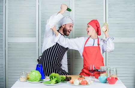 Fresh vegetarian healthy food recipe. Join healthy lifestyle. Fresh vegetables. Vegetarian family. Woman and bearded man cooking together. Chefs of organic food restaurant. Cooking healthy food