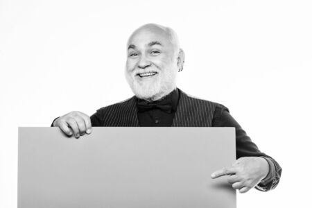 Elderly people. Man bold head and gray beard hold poster for advertisement copy space. Senior means experienced. Senior man recommend something. Senior holding blank sign board and looking at camera