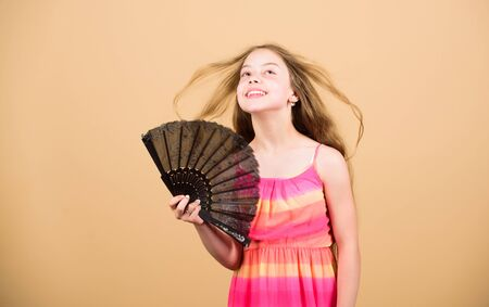 Air conditioner. Waving to create current air. Little girl waving elegant fan. Summer heat. Fresh air. Kid girl fanning herself with fan. Cooling and ventilation. Conditioning system. Climate control