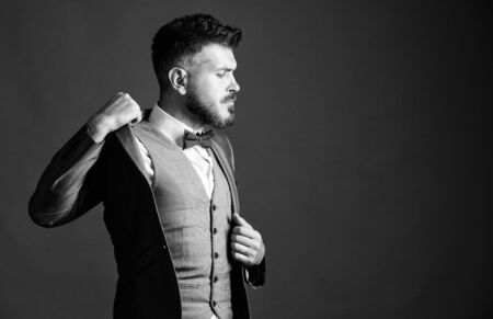 businessman with beard in tie. mature illusionist. Bride groom ready for wedding. esthete. stylish art director. business in modern life. bearded man in formal tuxedo suit. Perfection in every detail
