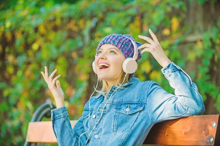Music is so much fun. modern technology instead of reading. relax in park. hipster girl with mp3 player. listening music in park. hipster woman in headphones. audio book. style and music. love music