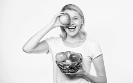 True happiness. orchard, gardener girl with apple basket. autumn harvest. Spring seasonal fruit. farming concept. healthy teeth. vitamin diet and food shooping. Happy woman eating apple. Pick fruits