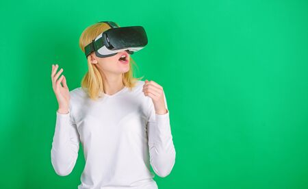 Funny young woman with VR. The woman with glasses of virtual reality. Woman using virtual reality headset. Virtual reality.