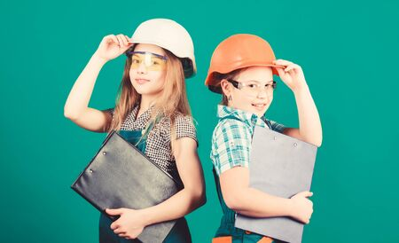 Home improvement activities. Builder engineer architect. Future profession. Kids girls planning renovation. Initiative children girls provide renovation their room green background. Renovation plan