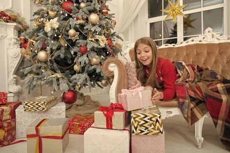 What a great surprise. The morning before Xmas. Little girl. Happy new year. Winter. xmas online shopping. Family holiday. Christmas tree and presents. Child enjoy the holiday