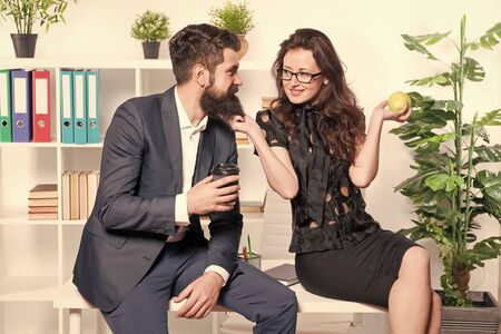 Its just a harmless flirt. Romantic couple conducting workplace affair. Boss and secretary having romantic relationship. Romantic love of bearded man and sexy woman in office. Romantic partnership Banque d'images - 131299635