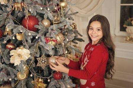 Happy new year. Christmas. Kid enjoy the holiday. small happy girl at christmas. decorate christmas tree. The morning before Xmas. New year holiday. little child girl likes xmas present. decoration Stockfoto