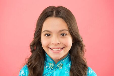 Cultural diversity. Little smiling girl wear eastern style clothes on pink background. Diversity concept. Diversity refers attributes that people use to confirm themselves with respect to others
