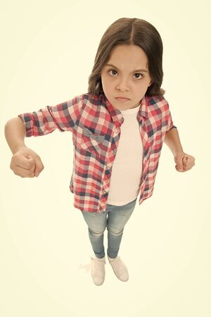 Stop bullying movement. Girl kid threatening with fist. Strong personality temper. Threaten with physical attack. Kids aggression concept. Aggressive girl threatening to beat. Threatening violence Imagens
