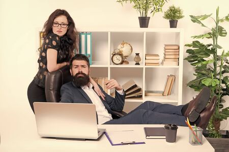 Working couple. Couple of lovers at workplace. Couple in love conducting affair at work. Romantic couple of bearded man and sensual woman in office Banque d'images - 131300331