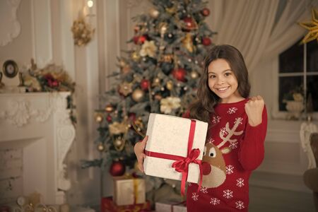 little child girl likes xmas present. Christmas. Kid enjoy the holiday. Happy new year. small happy girl at christmas. The morning before Xmas. New year holiday. Merry Christmas. Christmas Shopping Stockfoto
