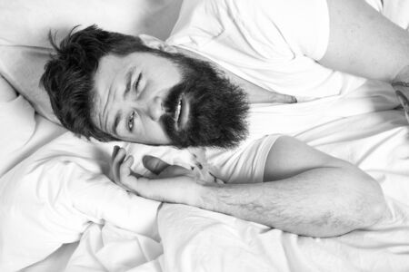 Lazy morning. Relax and sleep concept. Man bearded guy sleep on white sheets. Healthy sleep and wellbeing. Man bearded hipster sleepy in bed. Early morning hours. Insomnia and sleep problems Фото со стока - 131300341
