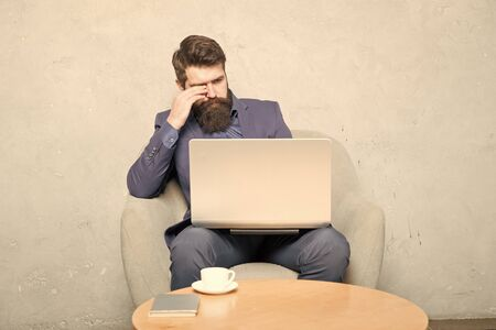 A successful business relies on technology. Businessman working at laptop technology for running business. Bearded man using technology in communication with customer. Business technology