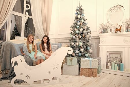 All I want for Christmas. xmas online shopping. Family holiday. Christmas tree and presents. Happy new year. Winter. The morning before Xmas. Little girls. Child enjoy the holiday Stok Fotoğraf