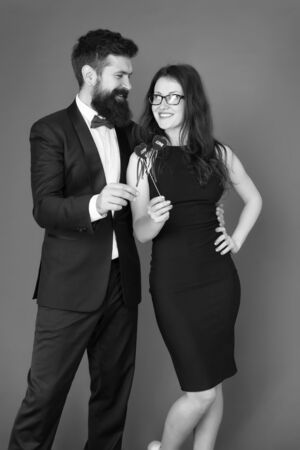 business couple in love on meeting. valentines day heart. bearded businessman with lady on business meeting. formal couple. business meeting. love date. tuxedo man and elegant woman at formal party